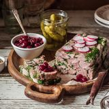 Ham Hock Terrine. Sliced Ham Hock Jelly Terrine with Pickles and Cranberry Sauce, square stock photo