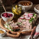 Ham Hock Terrine. Sliced Ham Hock Jelly Terrine with Pickles and Cranberry Sauce, square stock images