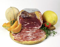 Sliced ham with melon. Sliced ham on cutting board Stock Photos