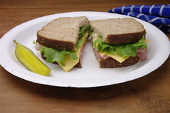 Sliced Ham Sandwich on Paper Plate Royalty Free Stock Photos