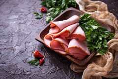 Sliced ham with spices. Selective focus royalty free stock photo