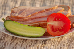 Sliced ham and vegetables on a plate royalty free stock image