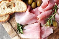 Sliced ham on wooden board. Fresh prosciutto. Pork ham sliced. Sliced ham on wooden cutting board. Fresh prosciutto. Pork ham sliced Royalty Free Stock Photos
