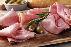 Sliced ham on wooden board. Fresh prosciutto. Pork ham sliced. Sliced ham on wooden cutting board. Fresh prosciutto. Pork ham sliced Stock Images
