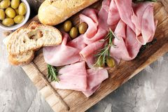 Sliced ham on wooden board. Fresh prosciutto. Pork ham sliced. Sliced ham on wooden cutting board. Fresh prosciutto. Pork ham sliced Stock Photography