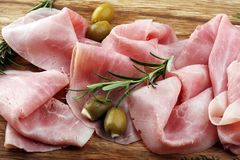 Sliced ham on wooden board. Fresh prosciutto. Pork ham sliced. Sliced ham on wooden cutting board. Fresh prosciutto. Pork ham sliced Stock Photo