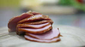 Sliced ham on a wooden board stock footage