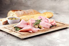 Sliced ham on wooden board. Fresh prosciutto. Pork ham sliced. Sliced ham on wooden cutting board. Fresh prosciutto. Pork ham sliced Stock Photos