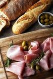 Sliced ham on wooden board. Fresh prosciutto. Pork ham sliced. Sliced ham on wooden cutting board. Fresh prosciutto. Pork ham sliced Stock Image