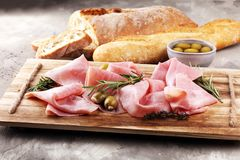 Sliced ham on wooden board. Fresh prosciutto. Pork ham sliced. Sliced ham on wooden cutting board. Fresh prosciutto. Pork ham sliced Royalty Free Stock Images