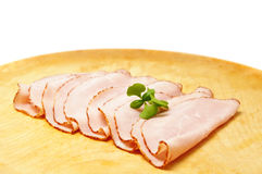Sliced ham on wooden plate Royalty Free Stock Photos