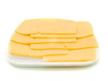 Sliced hard cheese over white Stock Photo