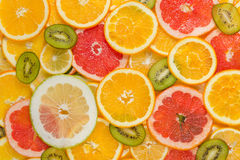 Sliced healthy fruits background Royalty Free Stock Photos
