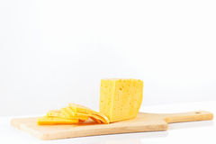 Sliced holland cheese on a cutting board Royalty Free Stock Photography