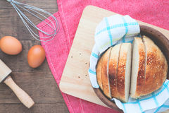 Sliced homemade bread with eggs on wood table with copy space Stock Image