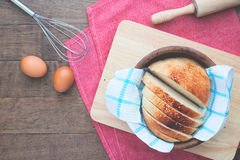 Sliced homemade bread with eggs on wood table with copy space Royalty Free Stock Photography