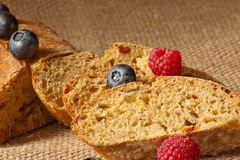 Sliced homemade bread with fresh berries. Black bread with sliced fresh berries Royalty Free Stock Photography