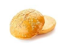 Sliced homemade burger bun on white stock photos