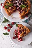 Sliced homemade cake with cherries closeup. vertical top view Royalty Free Stock Photography