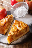 Sliced homemade warm apple pie close-up. vertical. Sliced homemade warm apple pie close-up on a table. vertical Royalty Free Stock Image