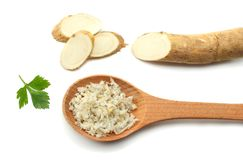 Sliced horseradish root with parsley isolated on white background stock photo