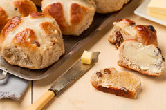 Sliced hot cross bun and knife with butter Stock Photography