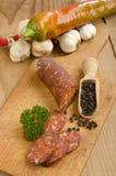 Sliced hungarian kolbasz on a wooden board Stock Photography