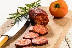 Sliced hungarian kolbasz on a wooden board Stock Image
