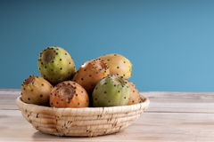 Sliced Indian Figs in a Bowl on White Wood Stock Images