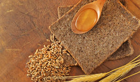 Sliced integral bread and honey spoon Royalty Free Stock Photography