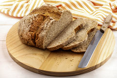 Sliced irish soda bread on a wooden plate Stock Photography