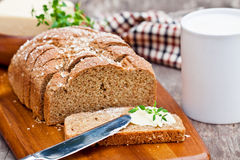Sliced Irish stoneground soda  bread with butter and thyme on the Royalty Free Stock Images