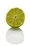 Sliced isolated green lemon (lat. Citrus). Eureka Royalty Free Stock Images