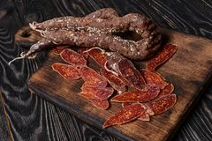 Sliced Italian sausage on cutting board.Selective focus Stock Photography