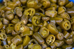 Sliced jalapenos for sale. A table is filled with spicy sliced jalapenos for sale at a market in Istanbul Royalty Free Stock Photography