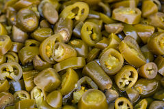 Sliced jalapenos for sale. A table is filled with spicy sliced jalapenos for sale at a market in Istanbul Royalty Free Stock Photos