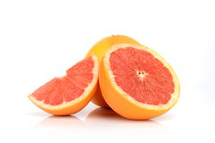 Sliced juicy grapefruits. Studio shot of sliced juicy grapefruits  on white Royalty Free Stock Images
