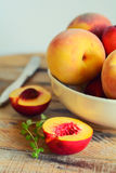 Sliced juicy peach in dish royalty free stock photos