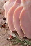 Sliced juicy roast pork meat. vertical Stock Image