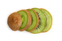 Sliced kiwi. A sliced kiwi spread out across a table Stock Images