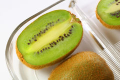 Sliced Kiwi. On glass plate Stock Photo