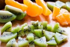 Sliced kiwi on a background of orange slices Stock Photo