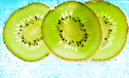 Sliced kiwi covered with bubbles Stock Photography