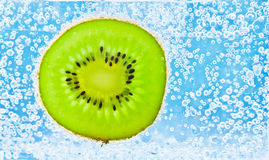 Sliced kiwi covered with bubbles Royalty Free Stock Photo