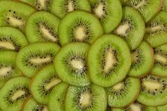 Sliced kiwi fruit background Stock Images