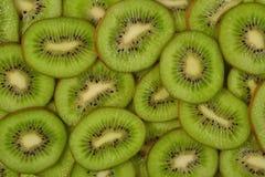 Sliced kiwi fruit background Stock Image