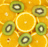 Sliced kiwi fruit and citrus orange Stock Images