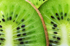 Sliced kiwi fruit on a full frame horizontal Stock Images