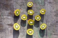 Sliced Kiwi Fruit on a gray vintage table.  stock image
