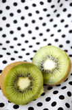 Sliced Kiwi Fruit On Polka Dots Royalty Free Stock Photo